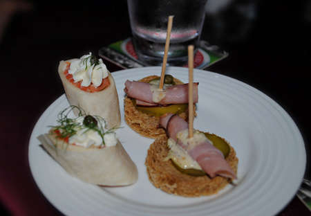 Delicious starters served in a white plate
