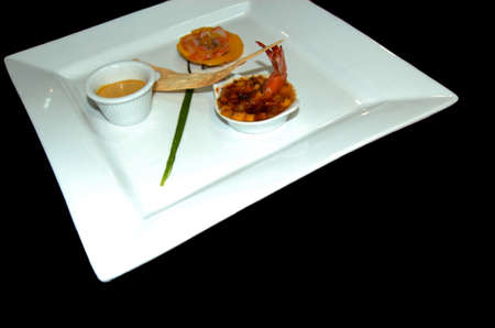 Small plates of shrimp appetizer with sauce