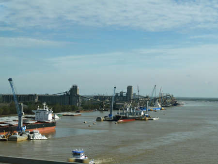 NEW ORLEANS, LOUISIANA—JANUARY 2017: Barges and cargo vessels at the Mississippi River in New Orleans, Louisiana on a cold morning.
