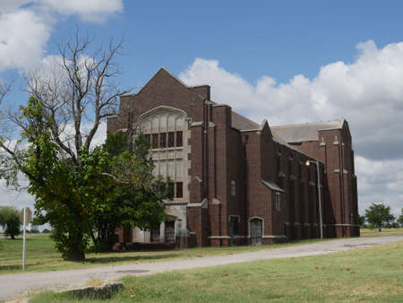 NORMAN, OKLAHOMA— SEPTEMBER 2015: One of the buildings at the abandoned psychiatric Griffin Memorial Hospital where 38 patients were burned to death in a fire in 1918.