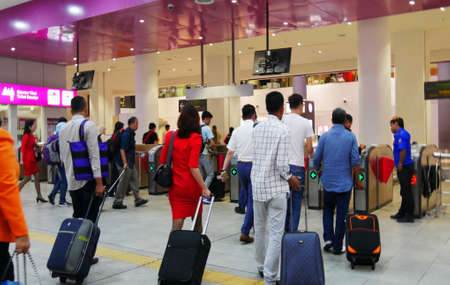 KUALA LUMPUR, MALAYSIA—MARCH 2016:  Passengers at the Kuala Lumpur International Airport exit through the automated gates to the KLIA Express terminal in March 2016.