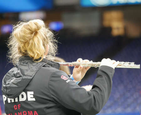 NEW ORLEANS, LOUISIANA—A female member of the Price of Oklahoma Marching Band plays her flute at rehearsals for the All Star Football performance in December 2016.