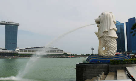 ONE FULLERTON, SINGAPORE—MARCH 2016: Merlion Park in Singapore, a very popular landmark and major tourist attraction near the Central Business District.