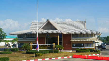 PATTANI, THAILAND—Façade of the Pattani Bus Terminal in the southern part of Thailand, with a flag waiting to be raised early one morning in March 2016.