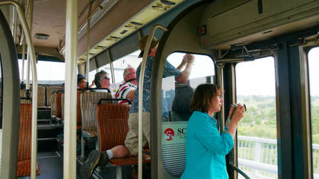 SINGAPORE—Passengers of a tour bus take photos of the cityscape as the tour bus speed through the streets of Singapore in March 2016. 報道画像