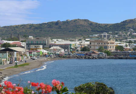 ST. KITTS, WEST INDIES—JANUARY 2017:  Coastal view of St. Kitts with buildings along the coastal road. 報道画像