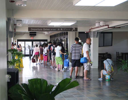 SAIPAN, CNMI—DECEMBER 2016:  Passengers checking in at the departure gates of Saipan International Airport, also known as Francisco C. Ada International Airport.