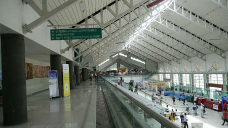 DAVAO CITY, PHILIPPINES—MARCH 2016: Wide shot inside the Davao International Airport, or Francisco Bangoy International Airport with duty free shops. It is the busiest airport in Mindanao.