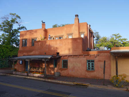 SANTA FE,  NEW MEXICO—SEPTEMBER 2017: One of the adobe buildings by the roadsides at the historic district of Santa Fe, New Mexico.
