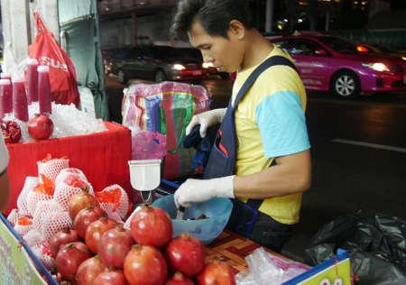 BANGKOK, THAILAND—MARCH 2016: Sidewalk fruit vendor in Bangkok