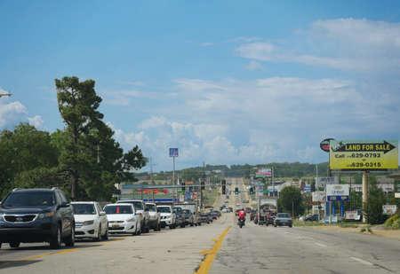 SILOAM SPRINGS, ARKANSAS—Light road traffic approaching Siloam Springs in Arkansas one afternoon in May 2017.