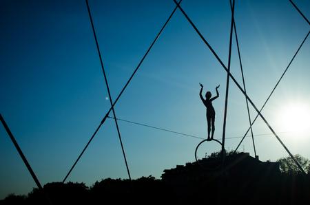 Krakow,Poland - May 12, 2018: Bridge in Krakow the K adka Ojca Bernatka or Father Bernatek Footbridge across the Vistula river, Krakow, Poland. Most artistic and quirky suspension bridge of Krakow. The acrobatic figures by Polish artist Jerzy Jotki Kedzio