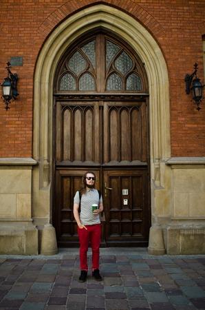 Man standing near door of Jagiellonian University in Krakow, Poland Фото со стока