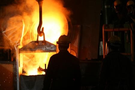 smelting: Smelting metal liquid iron foundry