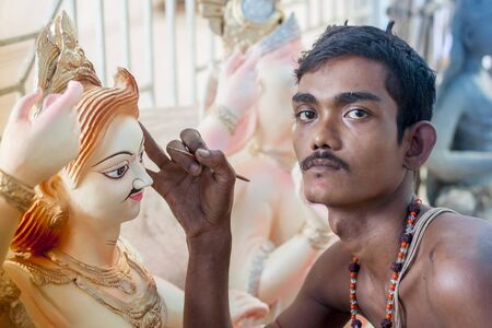 worshiped: A  Durga artist works on a clay idol of the Hindu Goddess Durga in preparation for the upcoming Hindu festival Durga Puja in Narayangonj, Dhaka, Bangladsh.