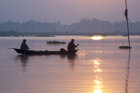 Sunrise time fisherman fishing in Kaliganga River, Dhaka, Bangladesh.