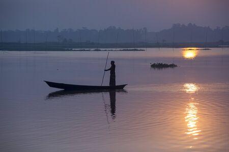 Sunrise with Fisherman's in Kaliganga river in Singair upazila, Manikgonj, Dhaka. Stock Photo