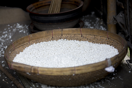 White puffed rice on a basket.