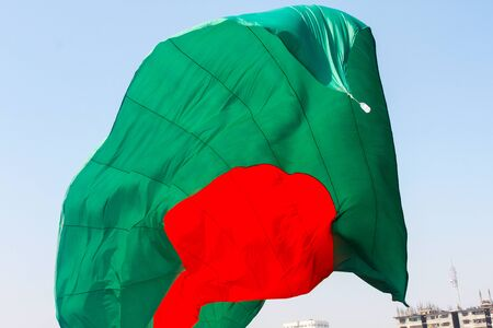 Bangladeshi Flag Waving in sky at Dhaka, Bangladesh. Stok Fotoğraf - 131993929