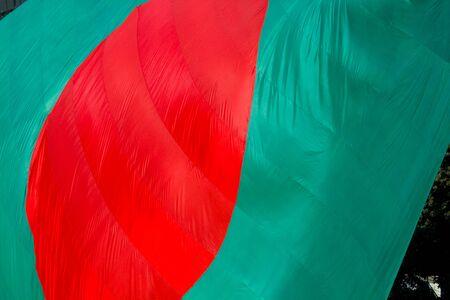 Bangladeshi Flag Waving in sky at Dhaka, Bangladesh. Stok Fotoğraf - 131994403