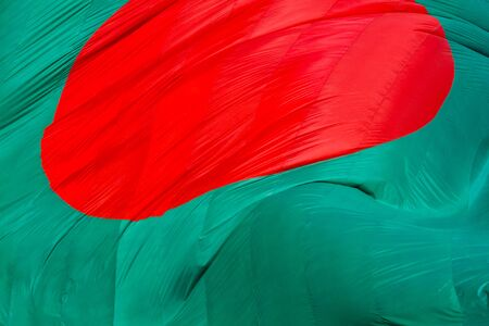 Bangladeshi Flag Waving in sky at Dhaka, Bangladesh. Stok Fotoğraf - 131993544