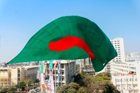 Bangladeshi Flag Waving in sky at Dhaka, Bangladesh. Stok Fotoğraf - 131993763