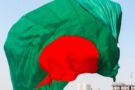 Bangladeshi Flag Waving in sky at Dhaka, Bangladesh. Stok Fotoğraf - 131993480