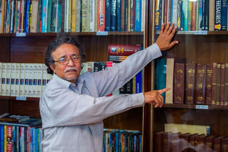 Bangladesh – October 18, 2016: Delwar Jahan Jhantu nne of the most populer Film Director & Producer shows his library at BFDC, Dhaka.
