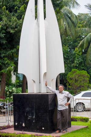 Bangladesh – October 18, 2016: Delwar Jahan Jhantu standing on a Liberation war monument at BFDC, Dhaka.