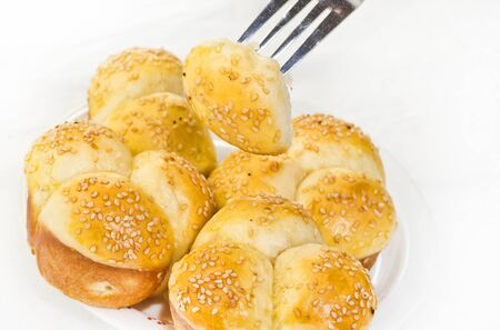 Soft No-Knead Heart shaped Buttery Dinner Rolls with Sesame seeds.