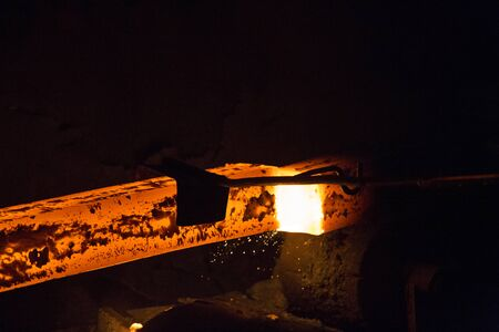 Gas cutting of the hot metal in steel plant at Demra, Dhaka, Bangladesh