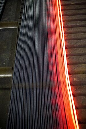 Heated metal pig gets squeezed and drilled at special metal forging unit at Brueck metal forging factory in Demra, Dhaka, Bangladesh.