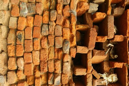 Old orange and red breakable brick arch wall with pattern. Stock Photo