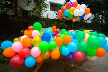 A pile of colorful gas-filled balloons stuck in the yarn.