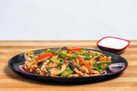 Chicken mushroom and capsicum stir fry recipe served on a sizzling plate. Chicken Fajita Recipe, Asian recipes.