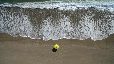 AERIAL: sunbathing on beach. No people only umbrella Antalya Stock Photo