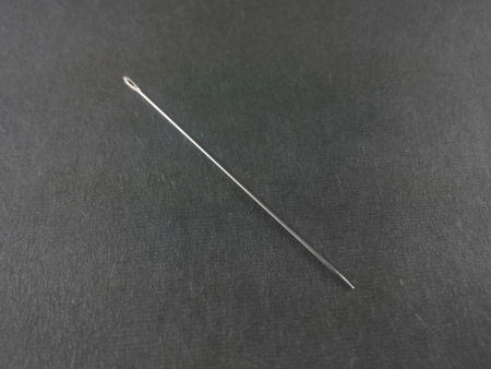 Sewing needle on black background