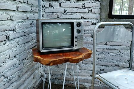 a room with an old iron chair and television, painted vintage, with classic charm but in the cold mountains