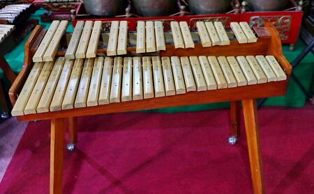 Kolintang or kulintang is a musical instrument consisting of rows of small gongs placed horizontally. This instrument is played accompanied by a larger hanging gong and drum. Stok Fotoğraf - 131808921