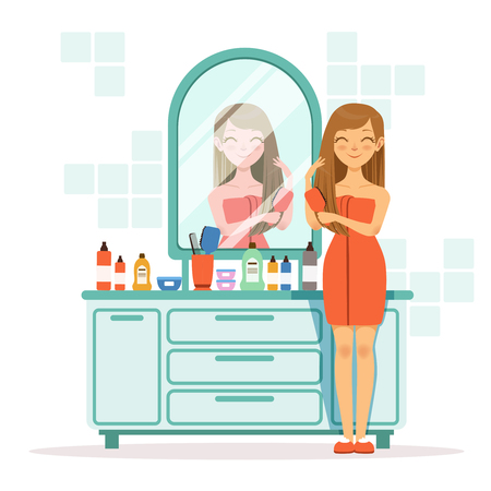 Happy woman combing hair a front of mirror