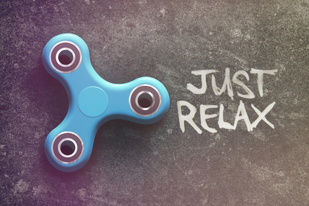 distraction: Spinner on the dark background of the word just and relax
