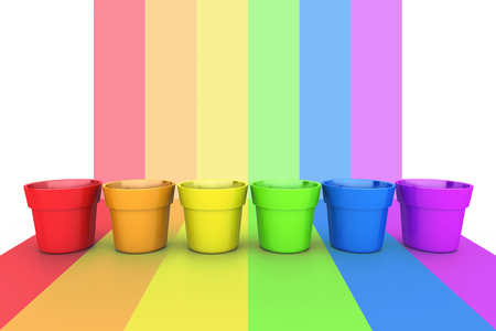 Colorful sample paint pots. Painting or decorating supplies on LGBT flag background