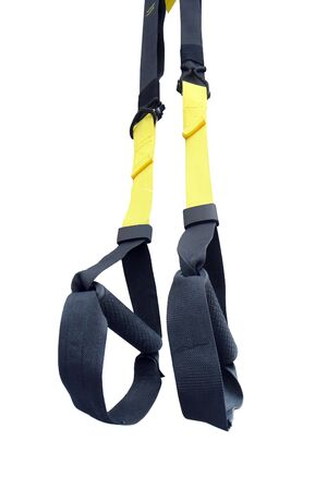 Suspension Weight Training. Black and yellow loop functional training equipment on white background isolated. Fitness and Gym workout items for Healthy. Sport accessories, top view. Reklamní fotografie