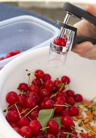 pitting: Pitting Sour Cherries in a bowl Stock Photo