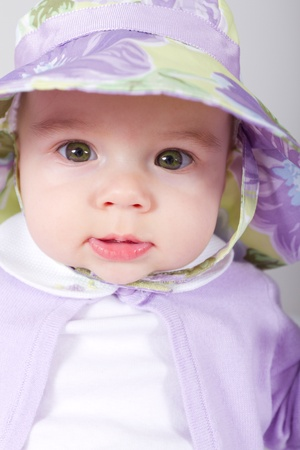 5 Months old Baby giving tranquil look in to lens with her complimenting clothing photo