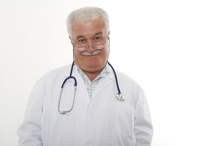 general knowledge: Experienced grey hair male doctor looking at the objective,