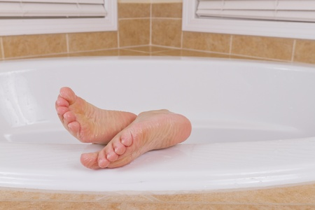 Wrinkled Feets coming out from a bathtub. photo