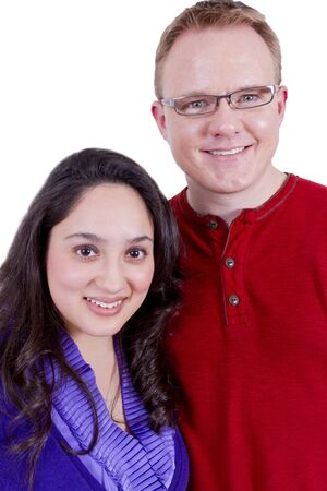 Beautiful Mexican wife and her clean cut American husband looking at camera happily. Stock Photo - 12190934