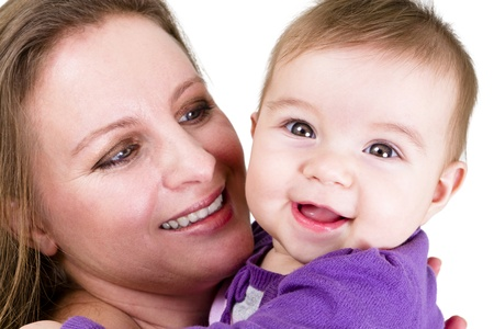 Proud mother looking at  smiling eight months old baby. Baby have a surprized happy look. Stock Photo - 13081503