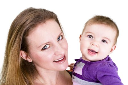 Pretty young mother and her cute baby posing. Stock Photo - 13081501